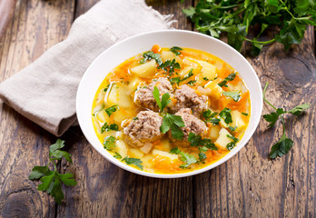 bowl of soup with meatballs and vegetables