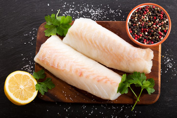 Foto auf AluDibond Fisch fresh fish fillet with ingredients for cooking