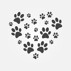 Heart with icons of dog paw prints vector illustration