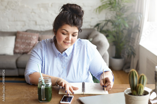 home office multitasking. Hardworking Positive Young Female Freelancer With Heavy Curvy Body Multitasking At Home Office, Texting Sms Office N