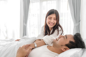 Romantic couple on bed and holding hands together, lifestyle concept.