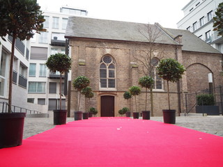 wedding set up with red carpet and trees