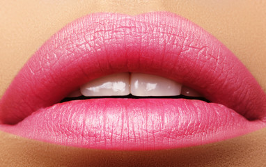 Sweet kiss. Perfect natural pink lip makeup. Close up macro photo with beautiful female mouth. Plump full lips