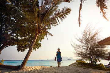 Tourist woman on the tropical beach