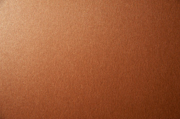 Texture of bronze brown glitter paper background. Macro photo