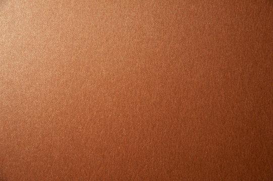 Texture of bronze brown glitter paper background. Macro photo