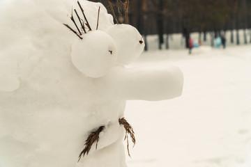 Snowman. Homemade snowman with snow