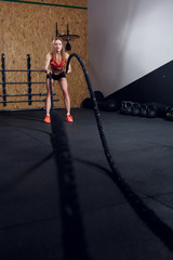 Picture of young athlete girl in training with two ropes