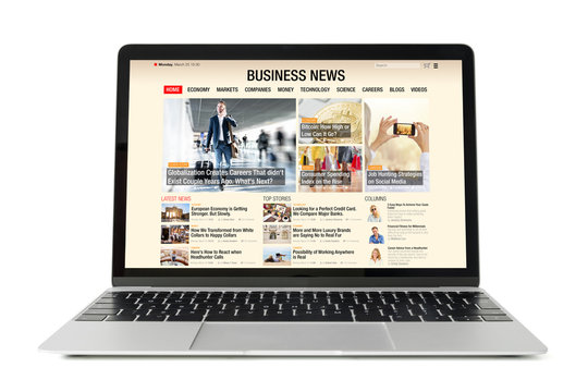 Business news website on laptop. All contents are made up.