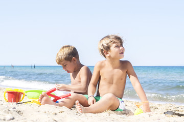 Boys playing in sand at beach