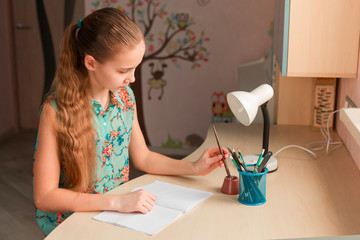 Cute little girl writing her homework