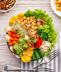 Buddha bowl, healthy and balanced vegan meal, fresh salad with a variety of vegetables, healthy eating concept. Top view