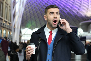 Shocked businessman on the phone