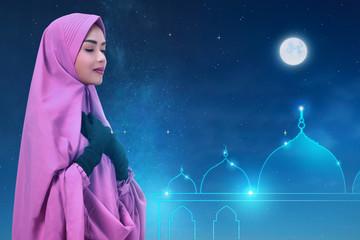 Pretty asian muslim woman with headscarf pray