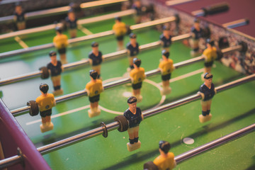 Table football game with yellow and blue players.