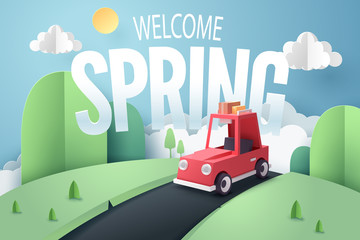 Paper art of red car stop at country road near forest and mountain with welcome Spring text