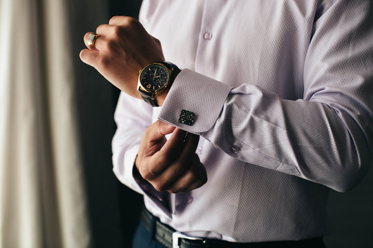 Businessman wears a watch. The ring on his finger. Success. Business.