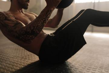 Man doing workout using medicine ball