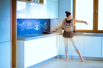 Fit and attractive young woman preparing healthy meal. Woman.