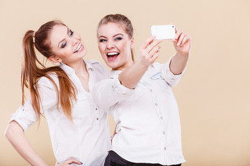friends student girls taking self photo with smart phone