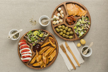 Vegetarian snacks on a wooden plate flatlay