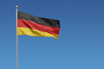 Flag of Germany in front of a clear blue sky