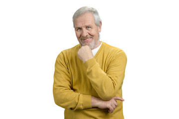 Portrait of handsome grandpa. Nice old man in yellow sweater. White isolated background.