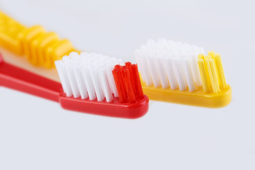 Red toothbrush isolated on white background. Means of personal hygiene.