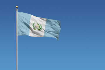 Flag of Guatemala in front of a clear blue sky