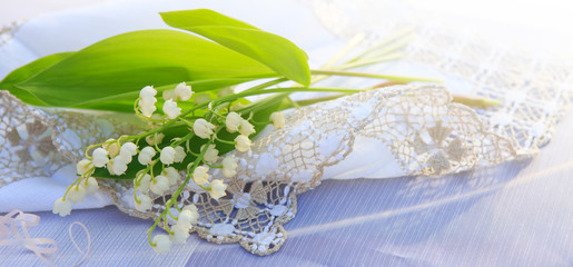 Lily of the valley bouquet on the table.