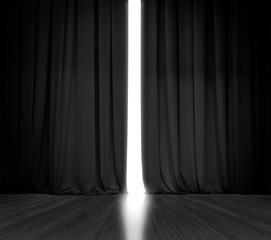 Black curtain background with bright light behind