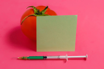 Concept of Non-natural Products, Gmo. Syringe, Sticker and Red Tomato on Pink Background,