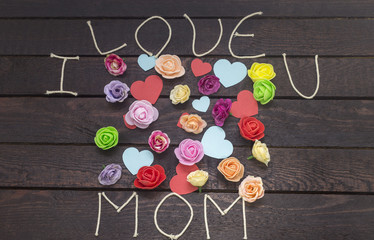 forming the word: i love MOM on background