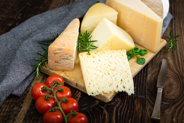 Cheeses with basil, rosemary and tomatoes.