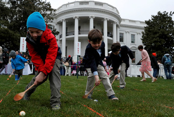 People participate in the annual White House Easter Egg Roll on the South Lawn of the White House in Washington