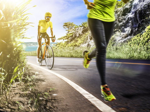 Professional triathlon man and woman running and ciclyng