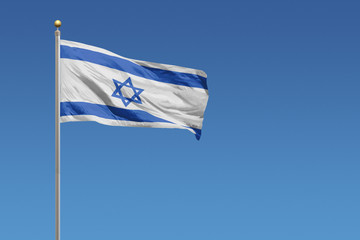 Flag of Israel in front of a clear blue sky