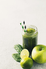 Green smoothie with ingredients, apples, lime, broccoli and spinach. Clean eating