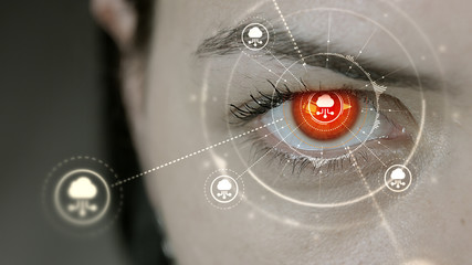 Young cyborg female blinks then cloud computing symbols appears.