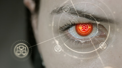 Young cyborg female blinks then computer network symbols appears.