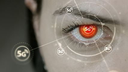 Young cyborg female blinks then high speed 5G symbols appears.