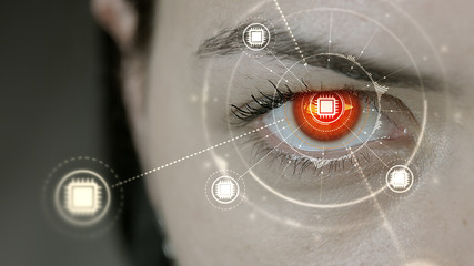 Young cyborg female blinks then computer cpu symbols appears.