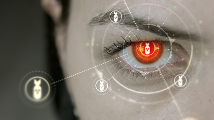 Young cyborg female blinks then nuclear bomb symbols appears.