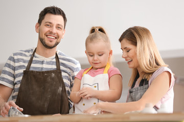 Happy family with flour together in kitchen