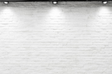 Empty white wall with halogen with lamps.