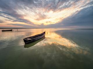 Beautiful morning landscape with boats on the lake at the sunrise, Razelm Lake, Sarichioi, Romania