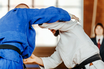 fight on tatami athletes judoka heavy weight