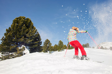 Woman skier move in snow mountains