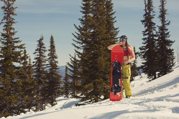 Snowboard female with board on snow mountain