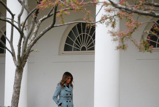 First lady Melania Trump walks by the rose garden after attending the annual White House Easter Egg Roll on the South Lawn of the White House in Washington